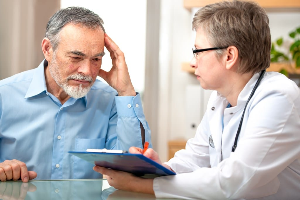 Male patient tells the doctor about his health complaints
